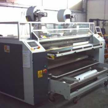 Occhiellatrice automatica per teli e tessuti stampati